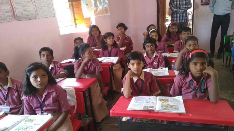 Distributing notebooks & schoolbags to underprivileged students